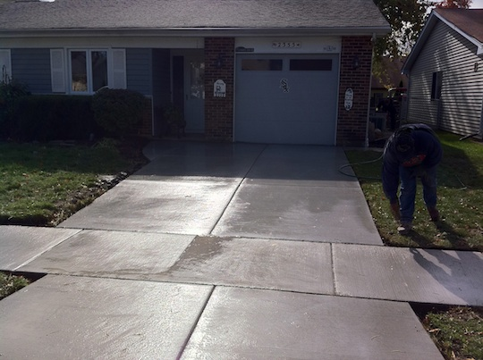 Masonry concrete tuck pointing chimney repair cost for New concrete driveway